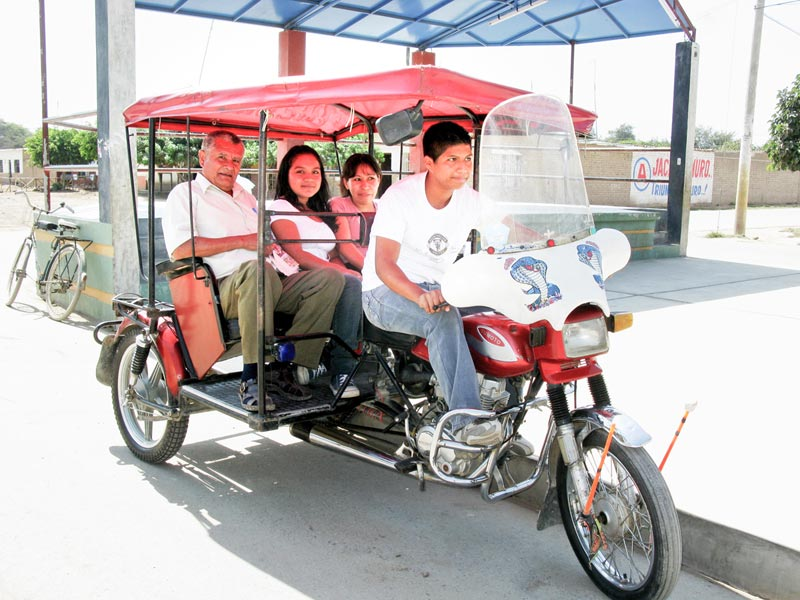 Peru People in a Mototaxi