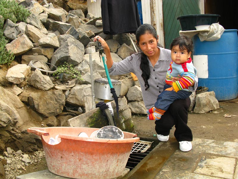 Peru Woman and Child at a Water Pump