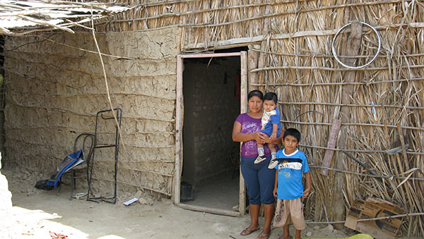 Peru Woman and Children Outside of Their Home