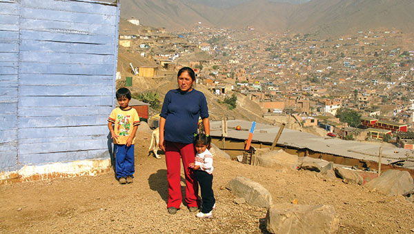 Peru Woman and Children Overlooking the City
