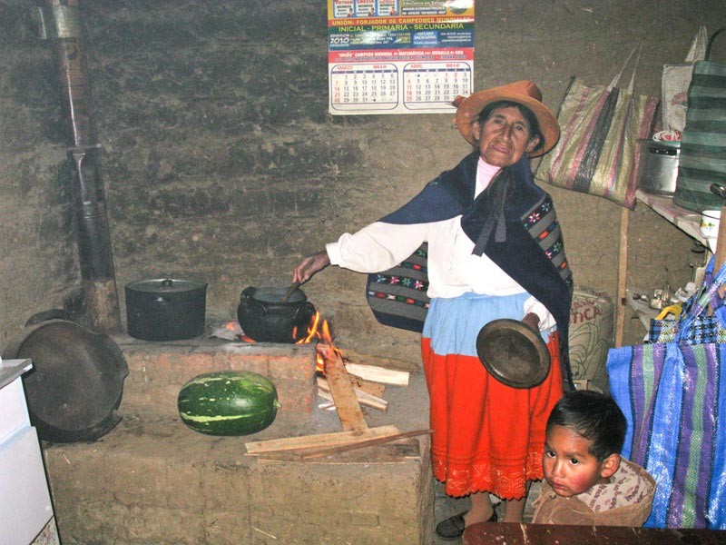 Peru Woman Cooking at a Fire