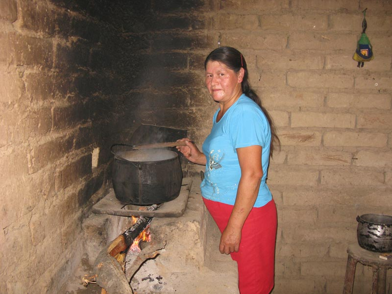 Peru Woman Stirring a Cooking Pot