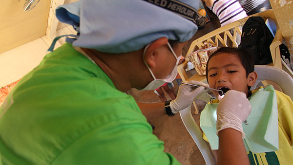Philippines boy getting dental exam