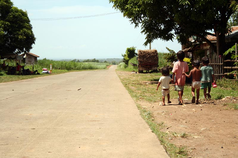 Philippines boys walking near road