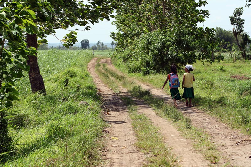 Philippines children on rutted road
