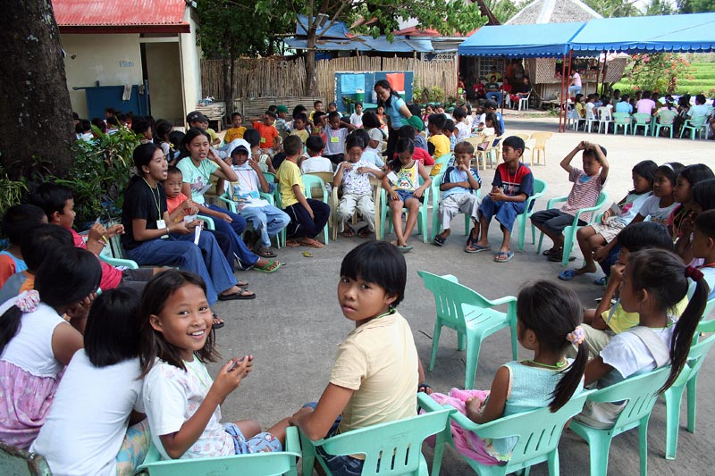Philippines children sitting in circle