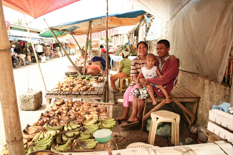 Philippines family selling plantains