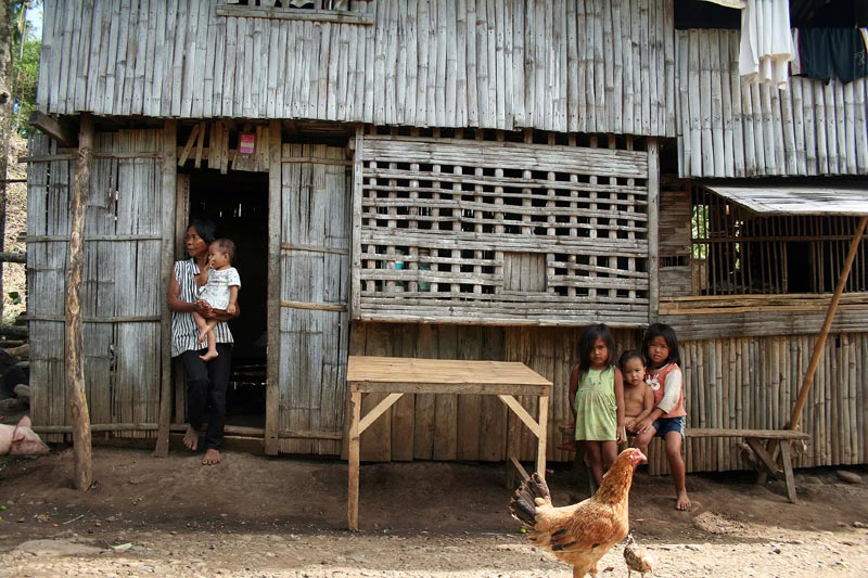 Philippines woman and children outside home