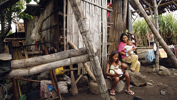 Philippines woman and children outside of home