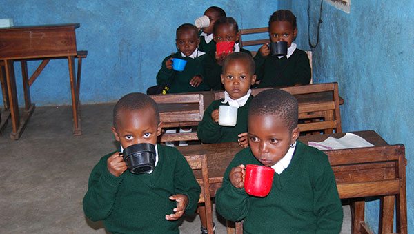Tanzania Boys Drinking Out of Cups