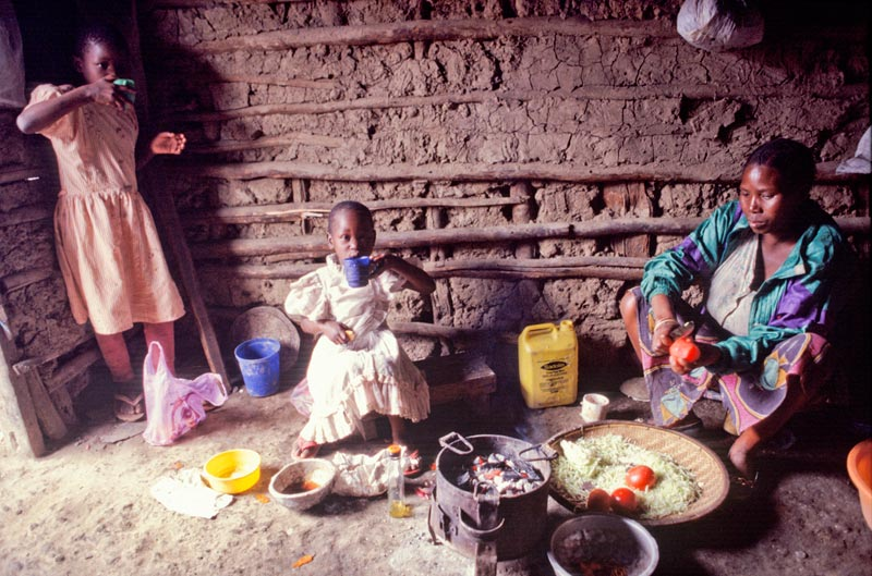 Tanzania Family Eating in a Small Home