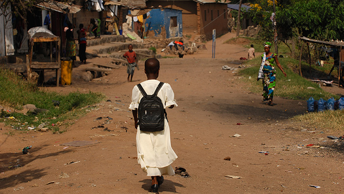 Tanzania Girl With Backpack Walking