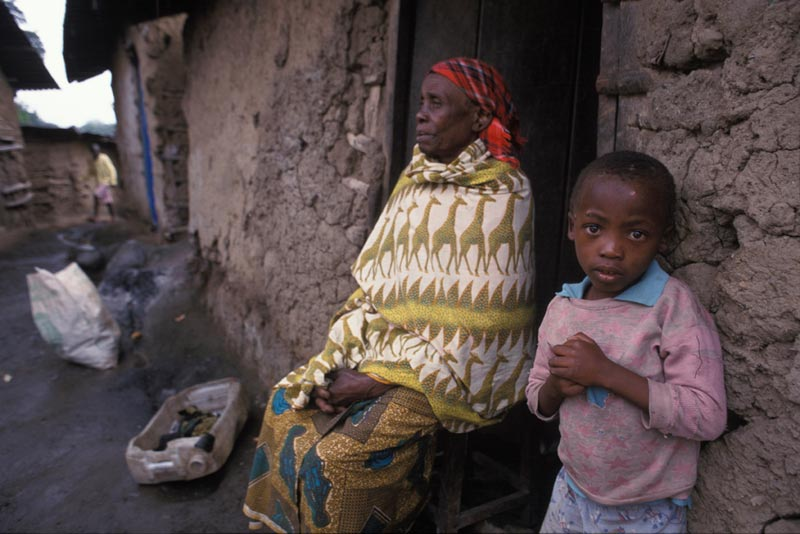 Tanzania Woman and Boy Outside of Their Home