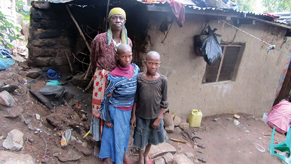 Tanzania Woman and Children Outside Home