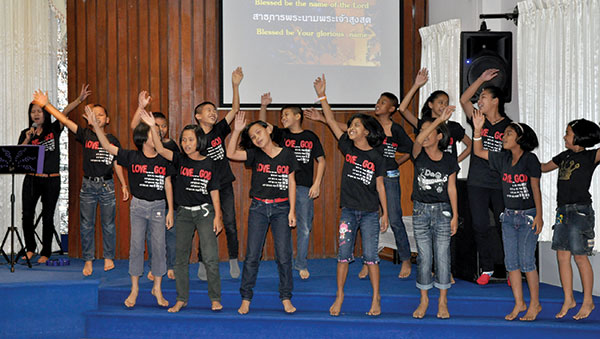 Thailand children raising hands