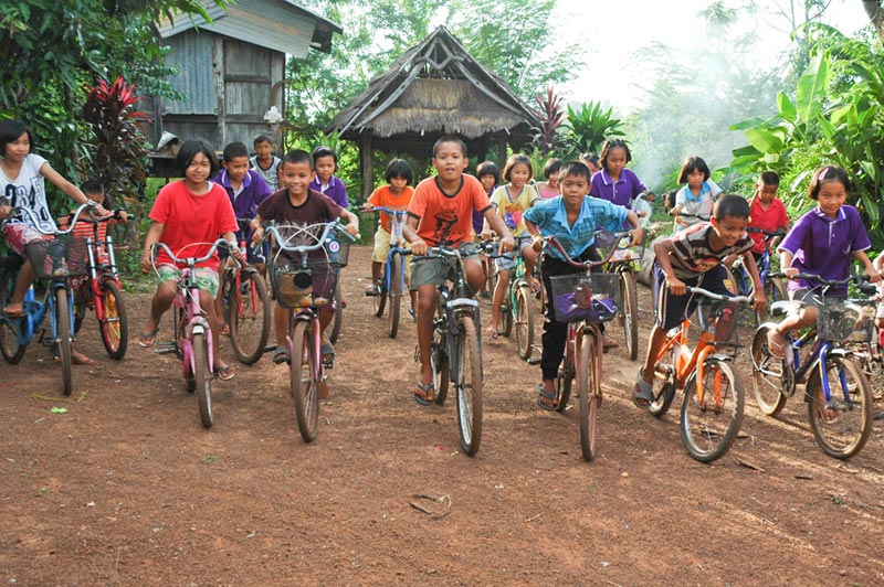 Thailand children riding bicycles