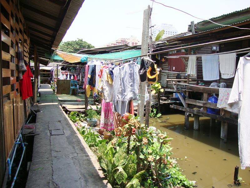Thailand clothes hanging between homes