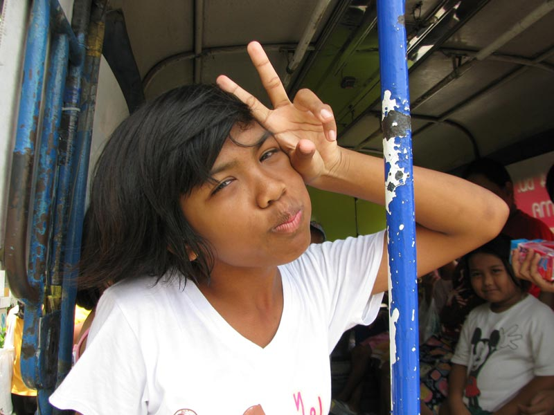 Thailand girl giving peace sign
