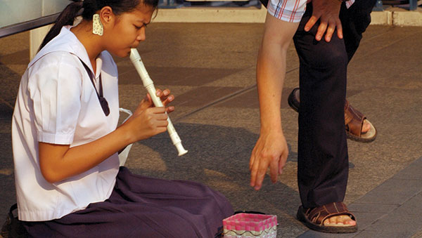 Thailand girl playing recorder