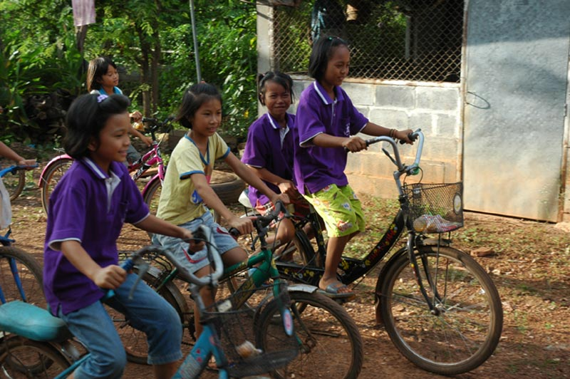 Thailand girls riding bicycles