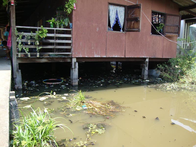 Thailand home over dirty water