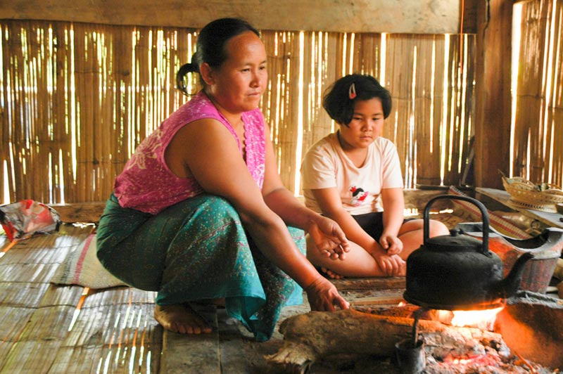 Thailand mother and daughter at cooking fire