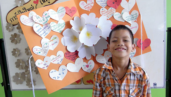 Thailand smiling boy with large card