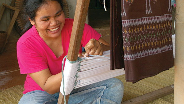 Thailand smiling woman weaving