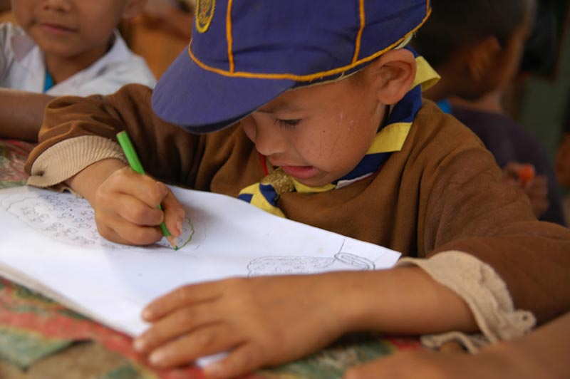 Thailand young boy drawing picture