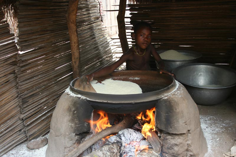 Togo Boy With a Large Cooking Pot