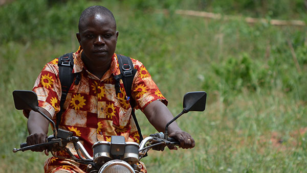 Togo Project Facilitator on Motorcycle