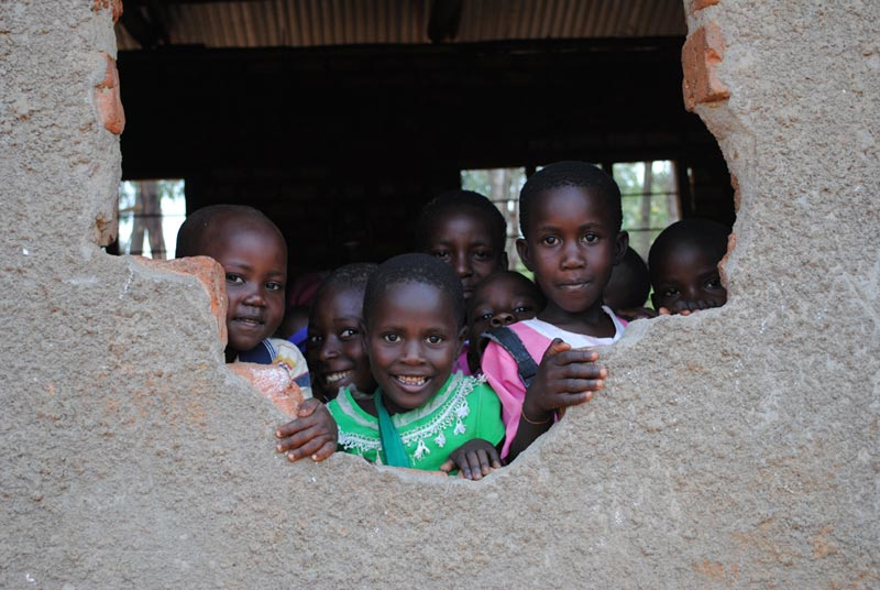 Uganda Children Looking Through the Window