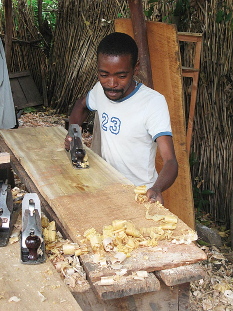 Uganda Man Working With Wood