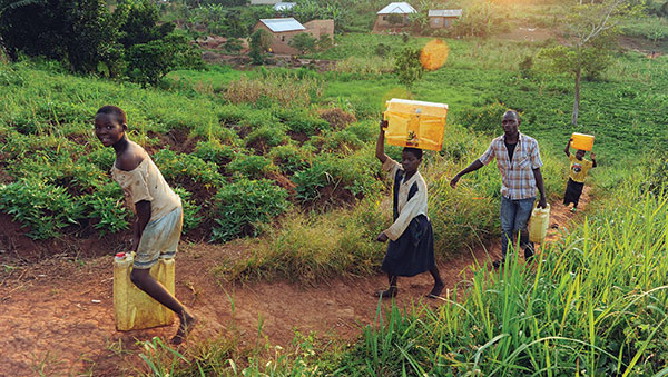 Uganda People Carrying Water Containers