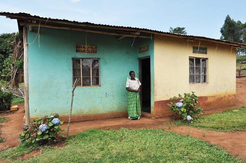 Uganda Woman Outside of Her Home