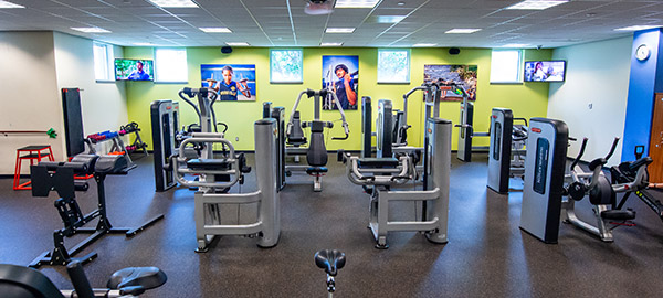 Compassion employee gym with different workout equipment