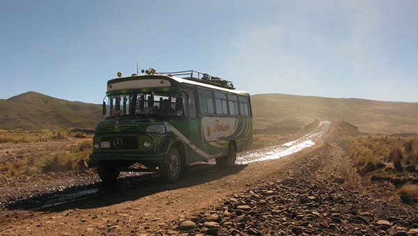 bolivia bus on dirt road