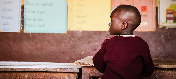 A child sitting in a classroom