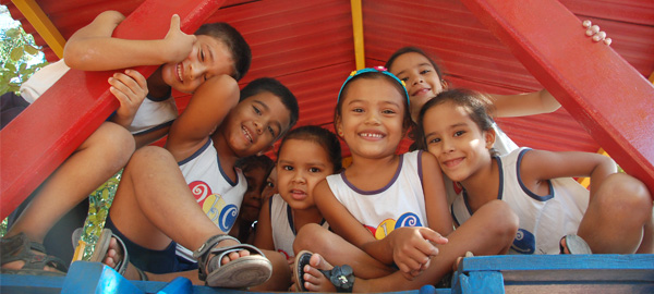 Children playing in a group and smiling