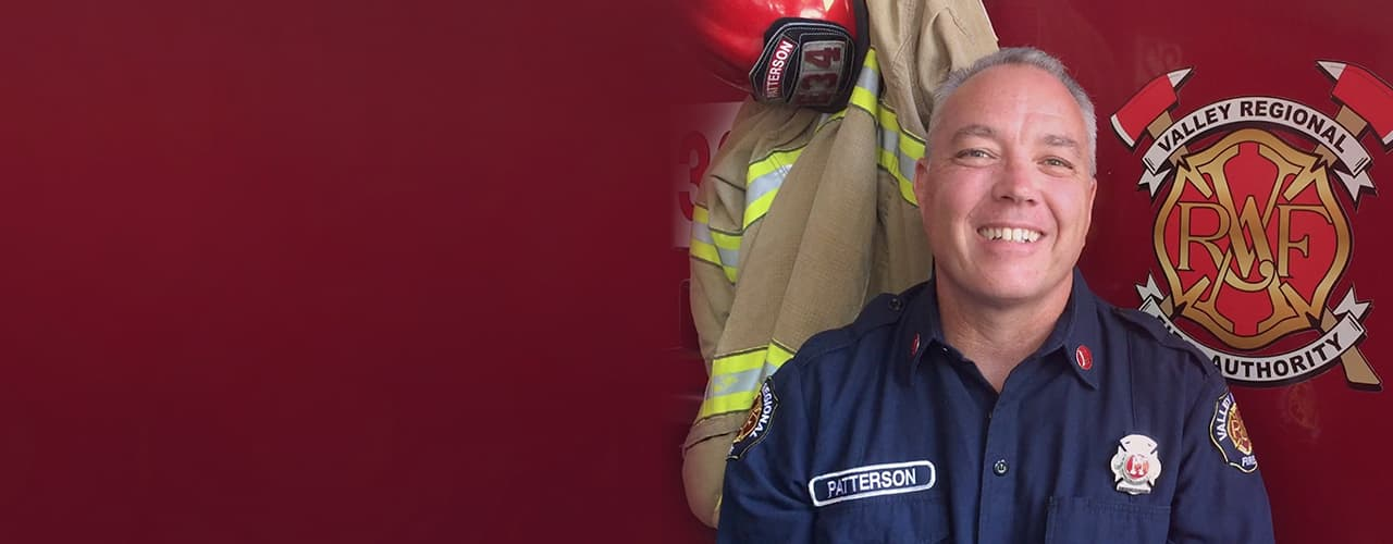Mike, a smiling firefighter