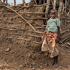 A child stands in the dry landscape of East Africa