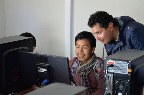 Two young men working at a computer