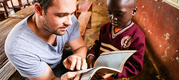 A sponsor reads with a child