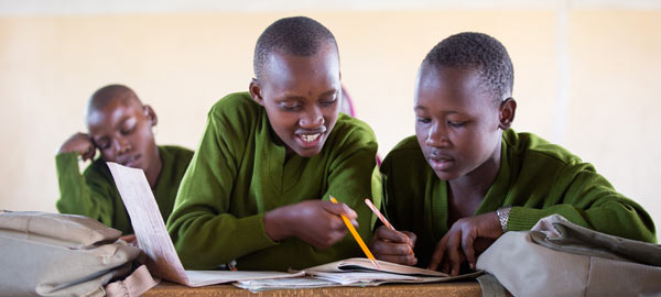 Two boys from Tanzania studying together