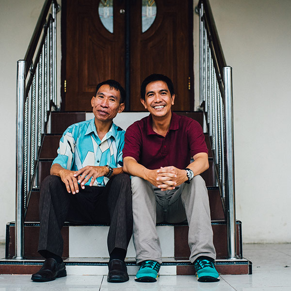 two men sitting on a set of stairs