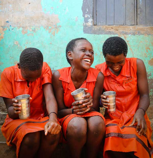Girls laughing with cups