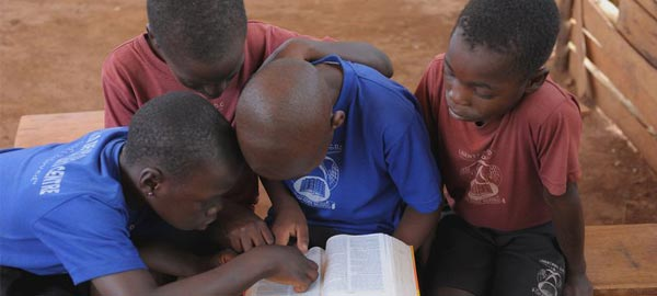 Children reading the bible together
